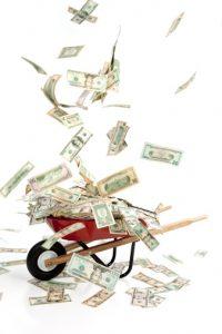 Objectif USA | 123658867 Wheelbarrow with cash